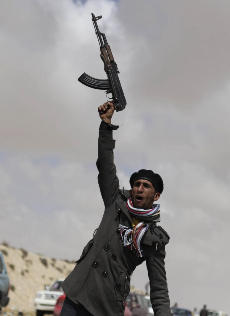 A Libyan rebel shouts religious slogans before heading toward the front line Saturday near Brega, Libya. The United States said it was ending its role in combat missions over the country Saturday, turning the task over to other nations.