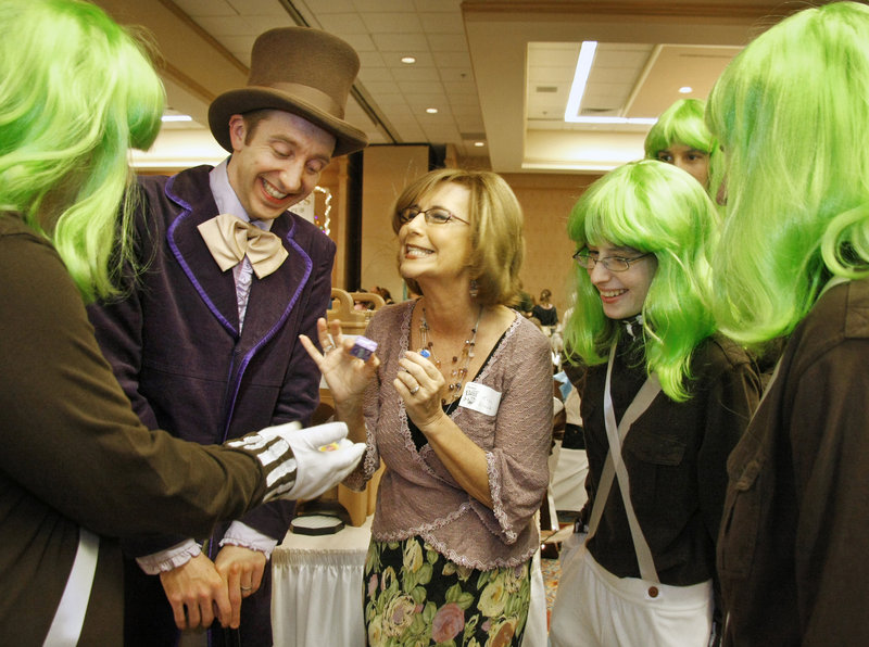 Kim Block of WGME-TV, center, enjoys a visit with Willy Wonka, aka Greg Caiazzo, at the Chocolate Lovers' Fling.