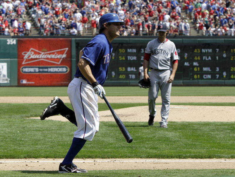 Ian Kinsler of the Texas Rangers strikes again on Sunday, hitting a home run against Clay Buchholz of the Red Sox. Kinsler and Nelson Cruz are the first set of teammates to homer in each of the first three games in a season. The Rangers won, 5-1.