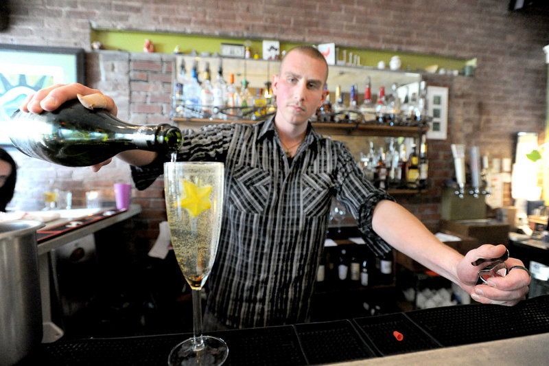 Kyle Miron mixes a house specialty drink called a Starfruit Sparkler at Figa in Portland.
