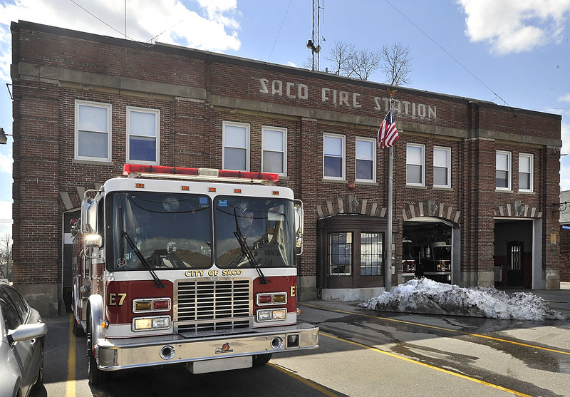 "A Saco firefighter backs a truck into the old Thornton Avenue station Wednesday, the last day of occupancy before everything was moved to a larger facility on North Street. ""There are a lot of memories here,"" said Capt. Michael Goulet."