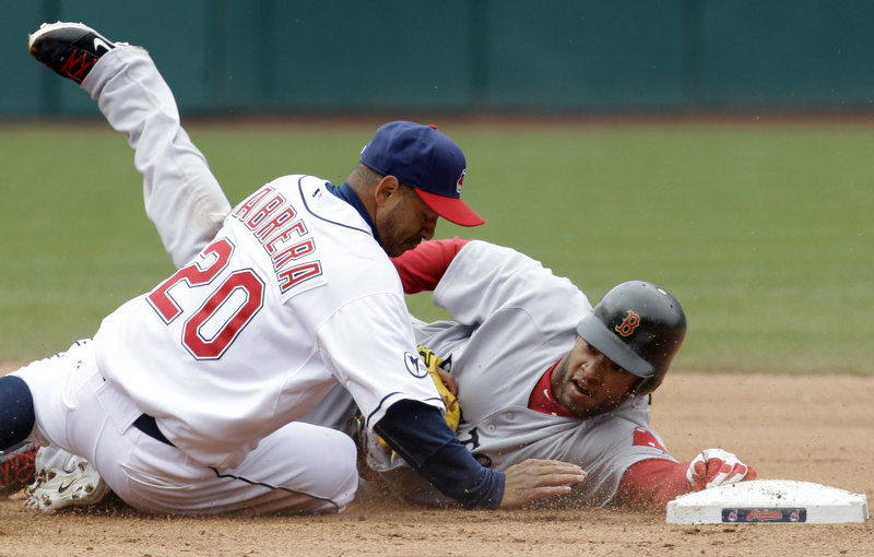 Darnell McDonald of the Red Sox reaches for the base, but not before Indians second baseman Orlando Cabrera tags him out to end the game. Cleveland won on a squeeze, 1-0.