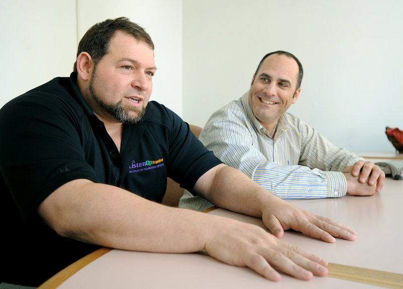 CEO Craig Handley, left, and President Tony Ricciardi of Listen Up Español work from an office in Portland.