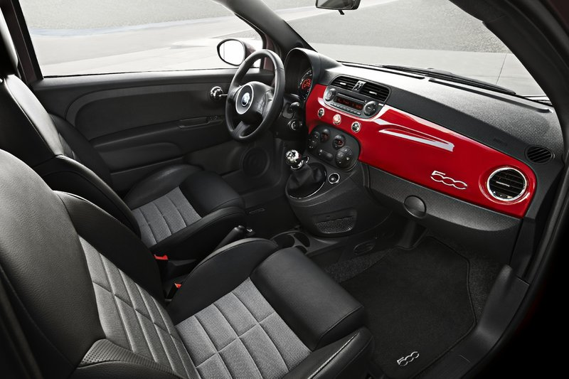 The interior of the Fiat 500 is well-equipped. It includes a Bose audio system with hands-free cellphone link, power windows, split folding rear seatbacks and a leather-wrapped steering wheel.