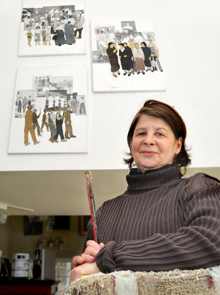 """Artist concept paintings for the controversial labor mural hang on a wall at Judy Taylor's studio in Tremont on Mount Desert Island. She rejects the idea that her murals serve as left-wing propaganda. """"Propaganda art is angry,"""" she says. """"My murals are not angry. They are warm."""""""