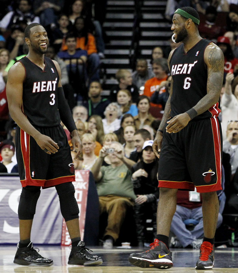 Dwyane Wade, left, and LeBron James have had a fine first season together with the Miami Heat. But one thing they haven't done is get by the Celtics, losing three times.