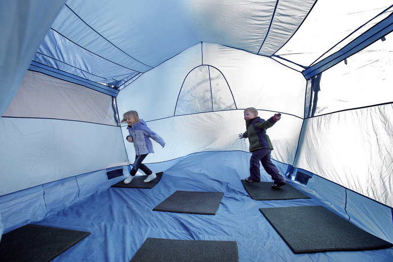 Sarah Dressel, 6, left, and her brother Matt, 3, play in a tent at the Spring Sports Weekend at L.L. Bean in Freeport on Saturday.