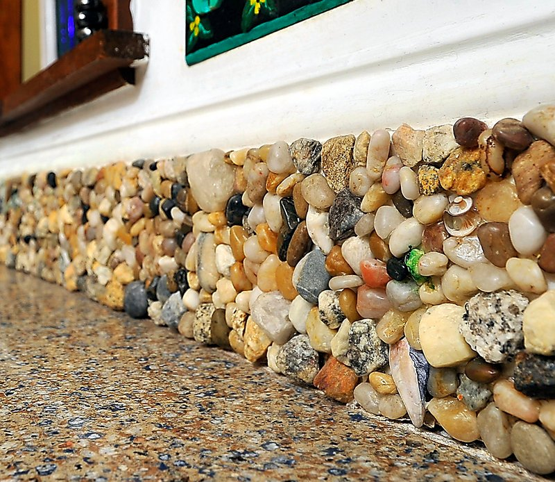 The backsplash in Amanda Edwards' Falmouth kitchen is made from rocks, shells, sea glass and more that her children found on trips to the beach.