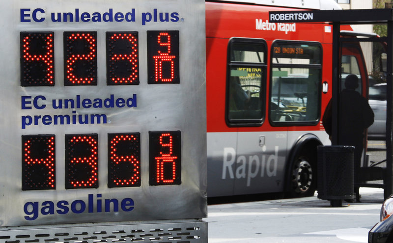 An Arco station in Los Angeles shows fuel above the $4 range in Los Angeles Monday. Some analysts say it is puzzling that less fuel is being bought overall, when growth in the economy should create more driving and thus more fuel purchased.