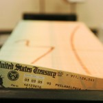 Trays of Social Security checks await mailing at the U.S. Treasury. Despite political risks, President Obama is expected to propose adjustments to the program in order to cut debt.