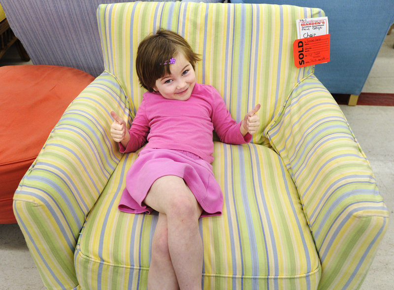 Lillian Hanley, 5, was pretty excited about the chair that her mother, Bethany, purchased there.