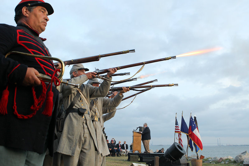 Civil War re-enactors fire a 21-gun salute Tuesday at Fort Johnson, near Fort Sumter, to commemorate the moment the first shots of the Civil War were fired 150 years ago.