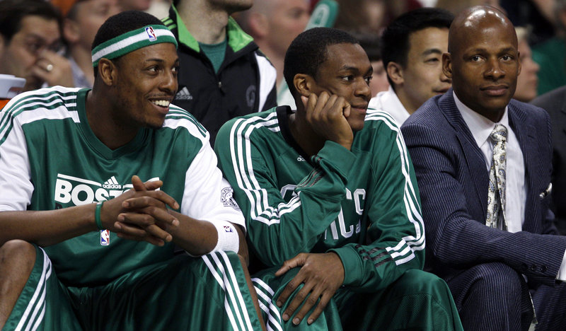 It was a night of rest Wednesday for Paul Pierce, left, and Rajon Rondo of the Boston Celtics as they watched their teammates beat the New York Knicks, 112-102. Enjoy it now. The playoffs start Sunday against the Knicks.