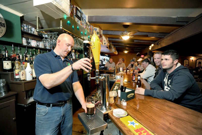 Bartender Tom Shotzberger pours a Guinness at Feile Irish Restaurant and Pub in Wells.