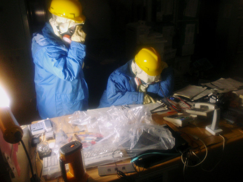 Tokyo Electric Power Co. workers collect data in the control room for Unit 1 and Unit 2 at the tsunami-crippled Fukushima Dai-ichi nuclear power plant in Fukushima, Japan.
