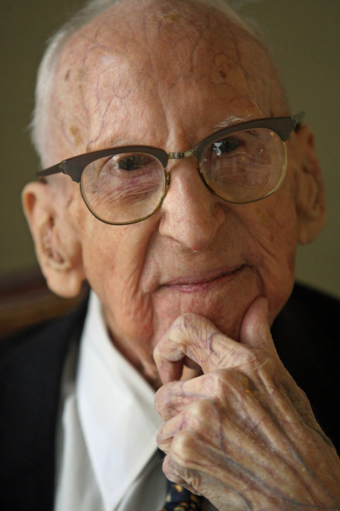 Walter Breuning, shown during an interview last October in Great Falls, Mont., was the world's oldest man, 26 days younger than the world's oldest person, a 114-year-old Georgia woman.