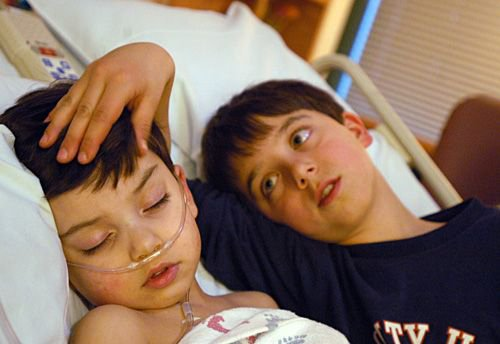 Samuel Habib, 3, comforted by his brother, Isaiah, was back in the hospital after pneumonia and other complications from a tonsilectomy at Dartmouth Hitchcock Medical Center in Lebanon, N.H.