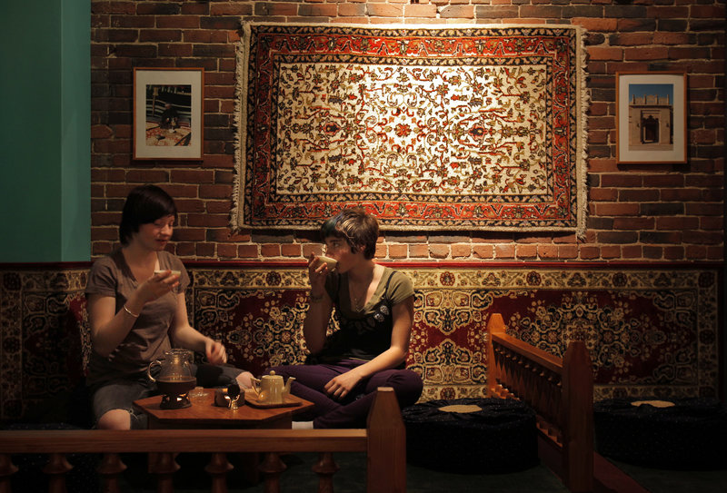 Mackenzie Lewis, left, and Chiara Morabito enjoy the tea at Dobra Tea.