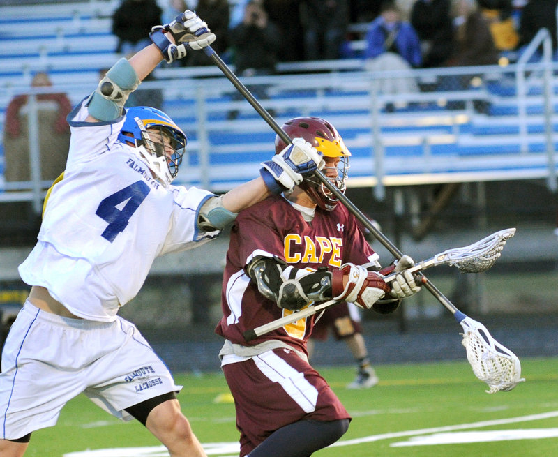 Mike Ryan of Falmouth makes an attempt to knock the ball away from Timmy Takach, who controls it for Cape Elizabeth.
