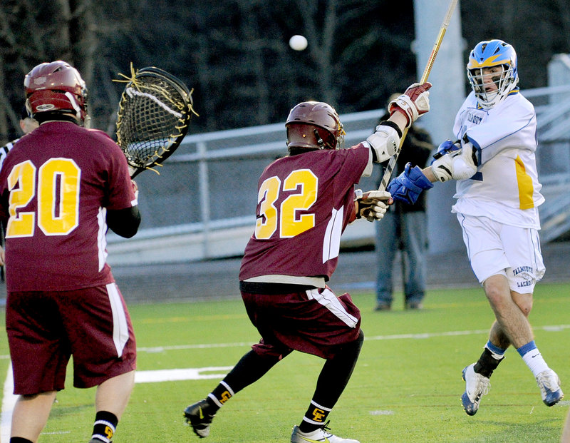 Mitch Tapley, who had two goals and four assists for Falmouth in a 12-4 victory Friday, shoots over Adam Havarsat of Cape Elizabeth as goalie Jack Ross prepares to make the save in a schoolboy lacrosse opener at Falmouth High.