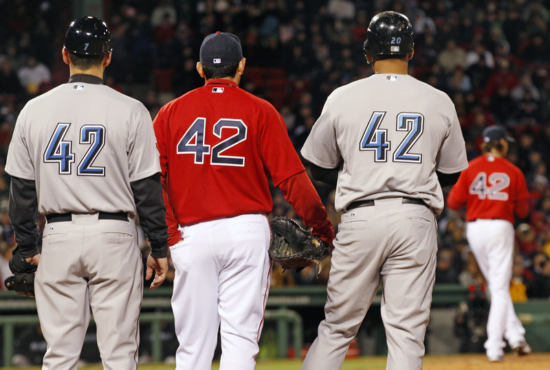 No, it's not trick photography. Every player and coach wore No. 42 Friday night to honor the 64th anniversary of Jackie Robinson – who wore No. 42 – breaking the color barrier.