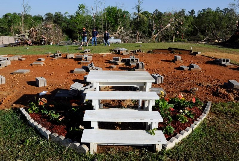 Only stairs and flowers remain Saturday after severe winds tore a mobile home off its lot late Friday night in Boone's Chapel, Ala. A tornado in the area had winds up to 150 mph.
