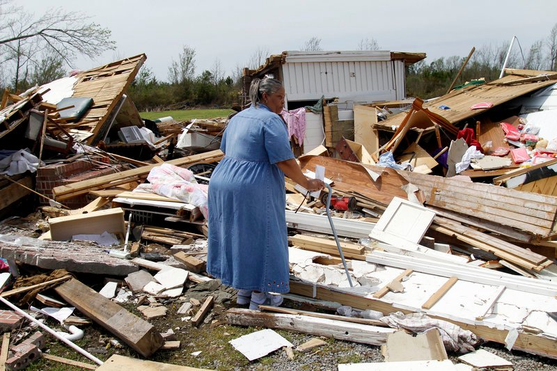 June White views Moore's Family Care Home in Colerain, N.C., after a tornado ripped through the area.