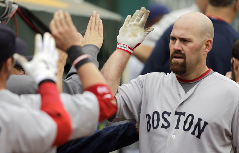 Kevin Youkilis is congratulated by his Red Sox teammates after hitting a home run off Oakland's Gio Gonzalez in the fourth inning of Boston's 5-3 win Wednesday.