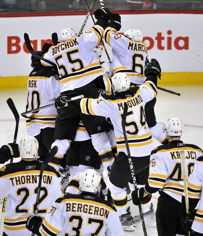 Nothing prompts an on-ice celebration like an overtime goal, and the Bruins got just that from Michael Ryder to beat the Canadiens and tie their playoff series at two games each.