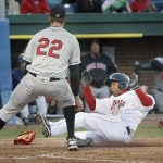 Jorge Padron of the Sea Dogs slides home safely home as New Britain pitcher Steve Hirschfeld awaits a throw following his wild pitch in the fourth inning of the Rock Cats 9-7 victory Friday night at Hadlock Field.
