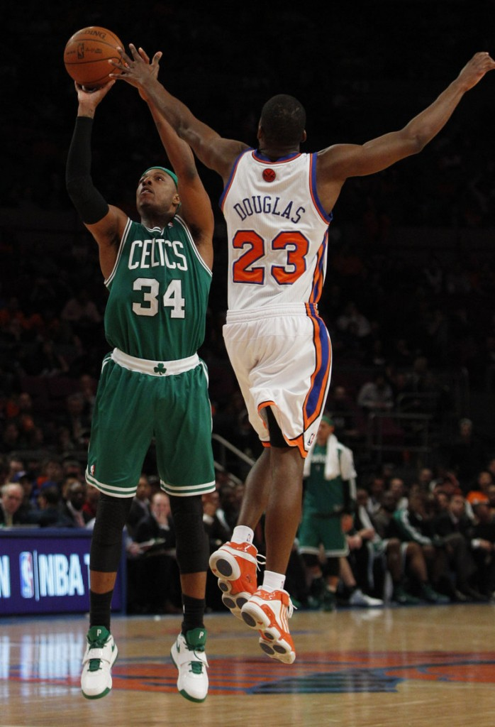 Boston's Paul Pierce shoots a 3-pointer over New York's Toney Douglas on Friday night in Game 3 of their opening-round playoff series in New York. Pierce hit six of his eight 3-pointers, and the Celtics rolled to a 113-96 victory.