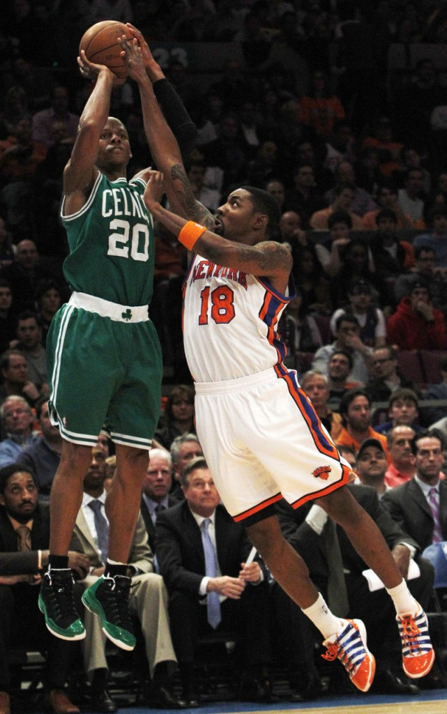 Ray Allen of the Celtics shoots over Roger Mason of the Knicks in the second half Friday night at Madison Square Garden. Allen scored 32 points and hit 8 of 11 3-pointers.