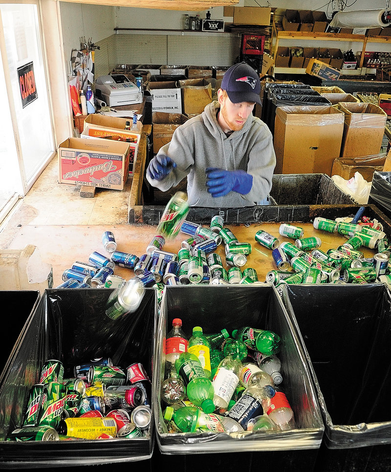 """Sean Putman-Labbe sorts returnables Friday at Bottoms Up in Augusta. """"Right now, we're considering expanding and hiring more employees,"""" he said. If the law is hobbled, that wouldn't be an option."""
