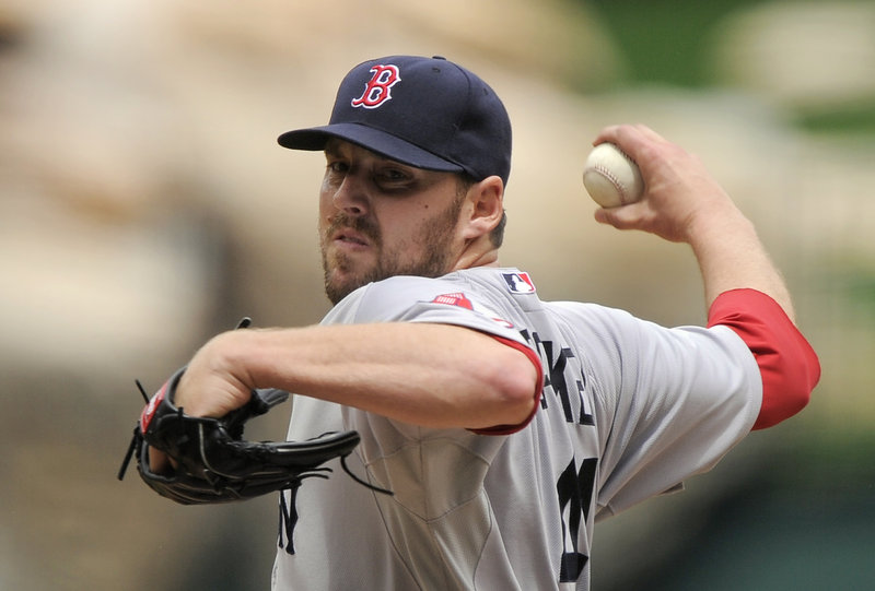 Red Sox starters have pitched 23 consecutive scoreless innings after John Lackey's eight-inning effort against his former team.