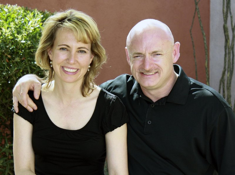 U.S. Rep. Gabrielle Giffords is shown with her husband, NASA astronaut Mark Kelly, in an undated file photo. Aides are preparing her to travel to Florida for his shuttle launch.