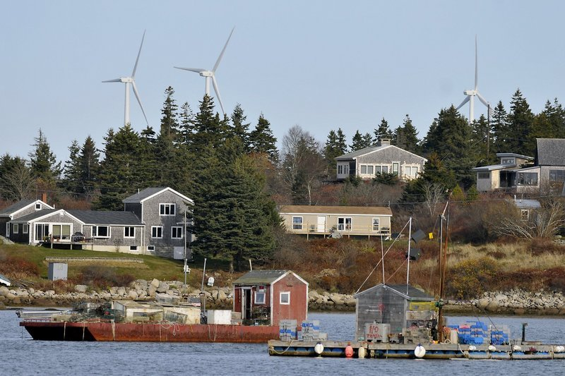 Vinalhaven's wind turbines overlook an iconic Maine scene, but such a presence devalues local properties, critics say.