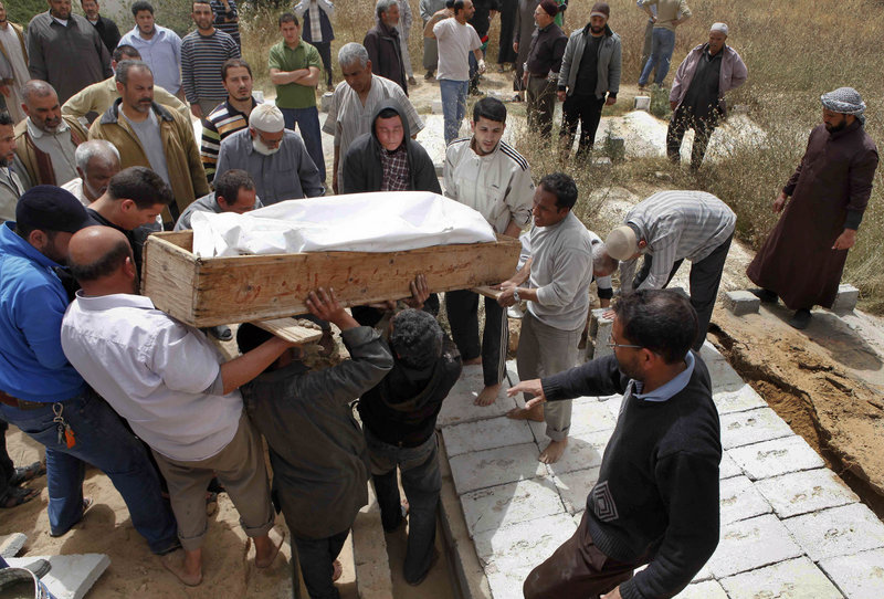 Mourners in Libya hold a funeral for a group of family members killed by shelling in Misrata on Monday. Gadhafi's troops on the outskirts of the city unleashed more shells into the city Monday, hitting a residential area and killing 10, including five in one family, according to a local doctor.