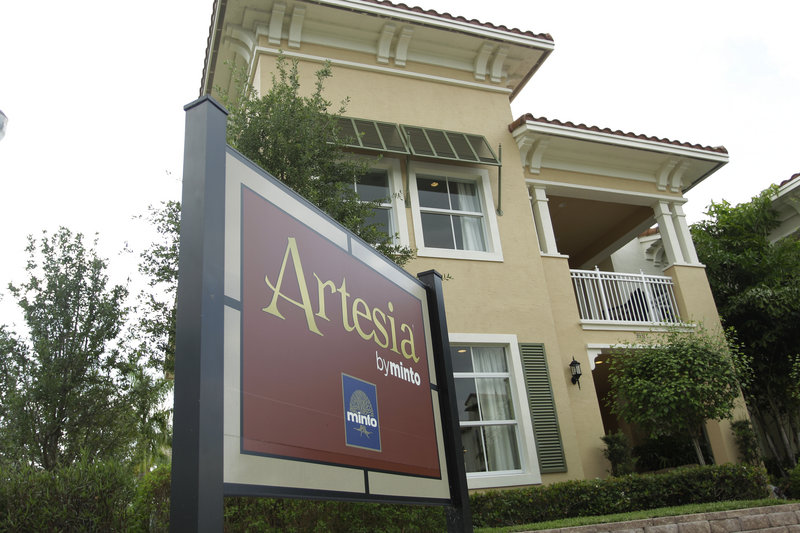 Houses are for sale in the new Artesia development in Sunrise, Fla. More people bought new homes in March, giving the battered industry a small lift after the worst winter for sales in almost 50 years.