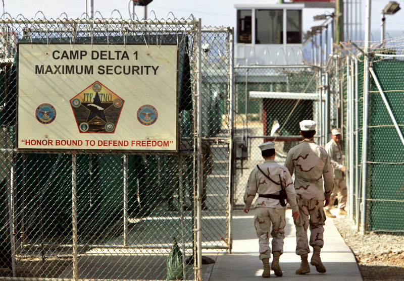 """U.S. military guards are seen at the Guantanamo Bay U.S. Naval Base in Cuba. A McClatchy Newspaper analysis of documents made public by the WikiLeaks website found many concerns about """"facts"""" provided by detainees."""