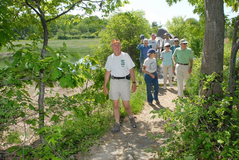 Tom Jewell, co-founder of Portland Trails, leads a group along one of the many trails in the Fore River Sanctuary. Portland Trails is celebrating its 20th anniversary at 5:30 p.m. Friday with a party and auction at the Portland Club.