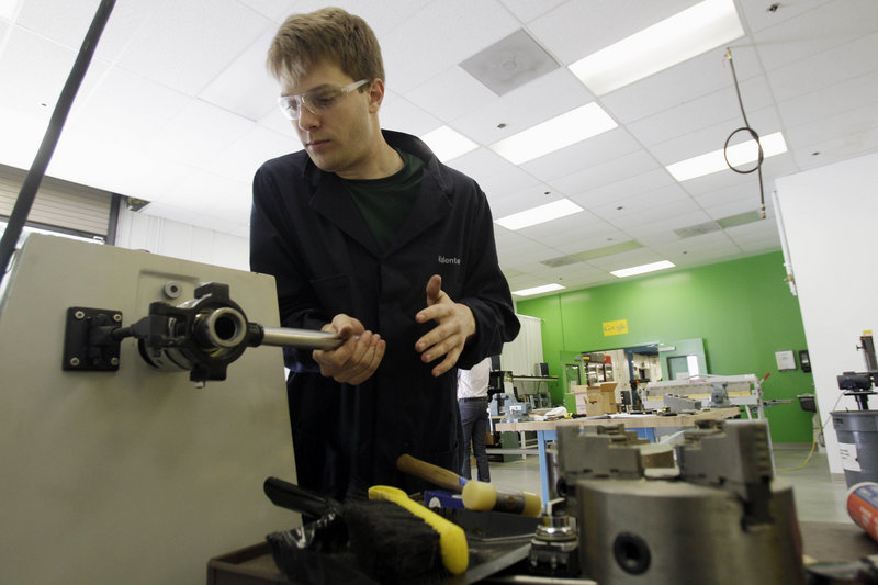 Matthew Valente works on a prototype at one of Google's four workshops – one each for metal, wood, welding and electronics.