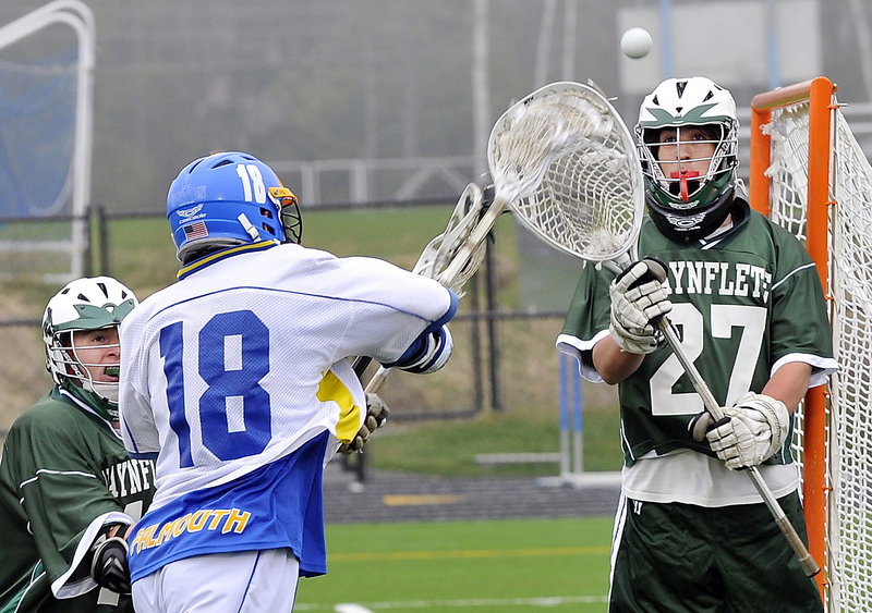 Willy Sipperly of Falmouth takes a shot stopped by Will Hallette of Waynflete as Don Wiener of the Flyers moves in Wednesday. Sipperly scored five goals in a 17-6 victory.