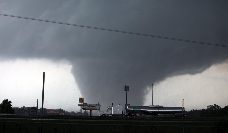 A tornado moves through Tuscaloosa, Ala., on Wednesday. A wave of severe storms laced with tornadoes strafed the South, with dozens killed and injured.