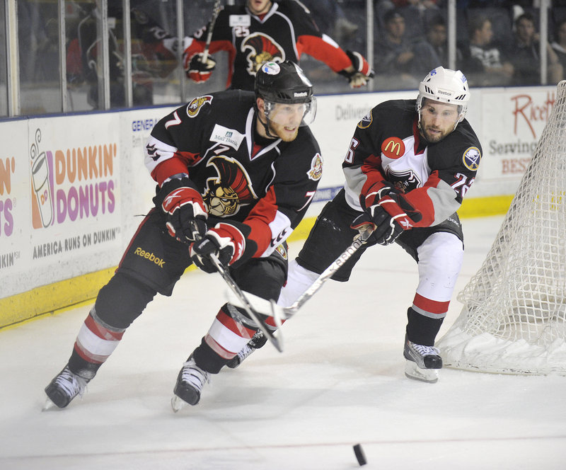 Geoff Kinrade of the Senators, left, circles the net while chased by Portland's Brian Roloff during Binghamton's 5-3 victory Thursday night. The Senators head home with a 2-0 lead in the best-of-seven playoff series.