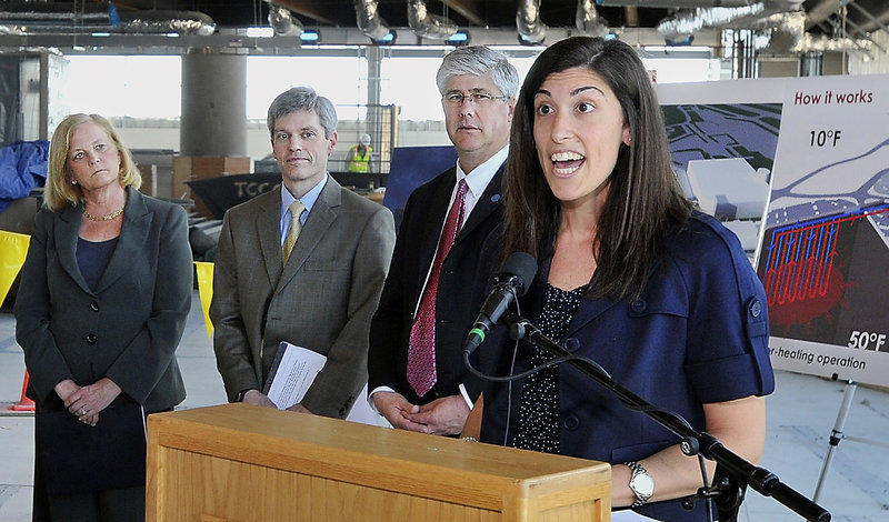 Christa Fornarotto, right, of the Federal Aviation Administration, praises the energy-saving geothermal heating and cooling system going into the Portland International Jetport. Other speakers, from left, are U.S. Rep. Chellie Pingree, jetport manager Paul Bradbury and Portland Mayor Nick Mavodones.