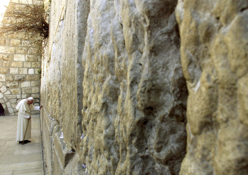 "Pope John Paul II prays at the Western Wall in Jerusalem in March of 2000. He was the first pope to visit a synagogue, where he referred to Jews as ""our older brothers in faith."""