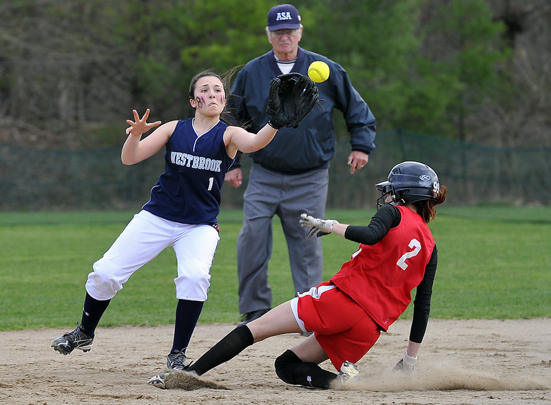 Allie Lemay of Westbrook covers second base as Kelsey Morton of South Portland slides in safely Friday during South Portland's 10-0 victory at Westbrook. The Red Riots improved to 4-0 and dropped the Blue Blazes to 1-3.