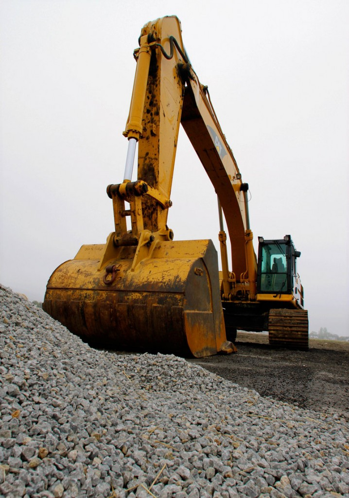 Caterpillar Inc. said Friday that its first-quarter net income more than quadrupled from last year as a growing economic recovery boosted demand for heavy equipment.