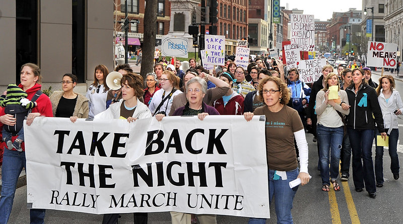 A chanting throng marches down Congress Street from Monument Square following Friday's 30th annual Take Back the Night rally in support of survivors of sexual violence.