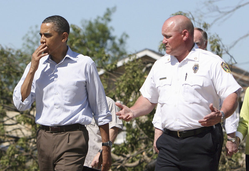 """President Obama and fire official Kevin Burgess tour a tornado-ravaged neighborhood Friday in Tuscaloosa, Ala. """"I've never seen devastation like this,"""" Obama said. Emergency management officials confirmed 238 deaths in Alabama in the wake of the storms."""